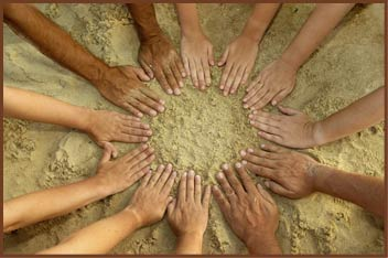 A diverse circle of hands finger tips pointing to the center forming a star burst